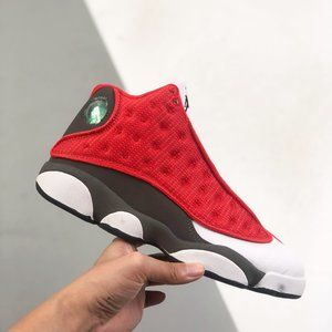 "Air Jordan 13 Retro"" high-top AJ13 wraps the shoe body with dark green pebbled l"